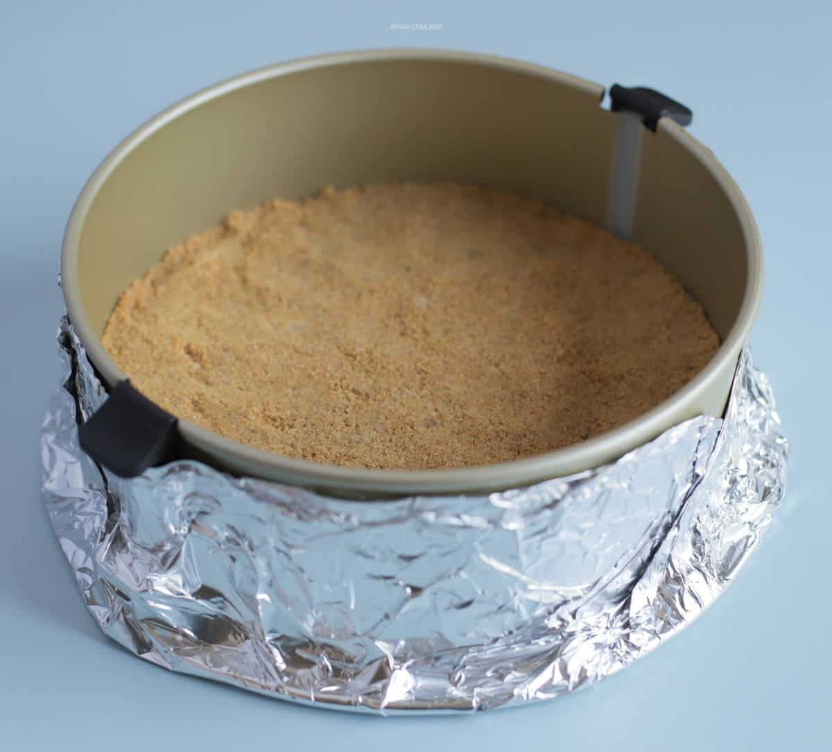 Cheesecake pan with parchment insert and exterior foil wrap
