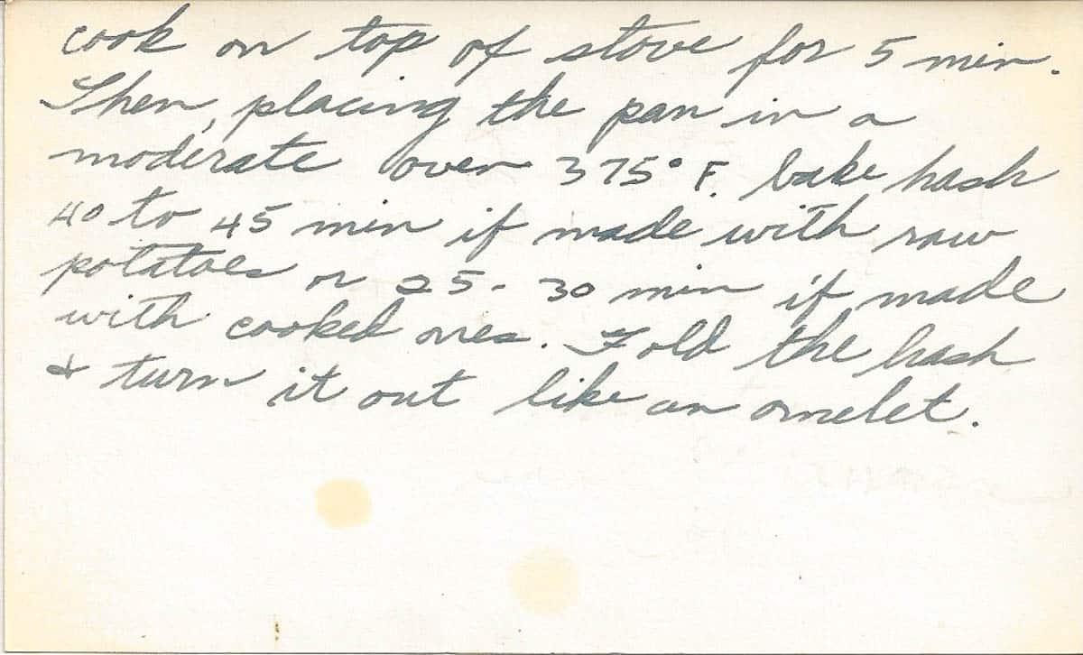 Photo of handwritten recipe cards showing vintage corned beef hash recipe