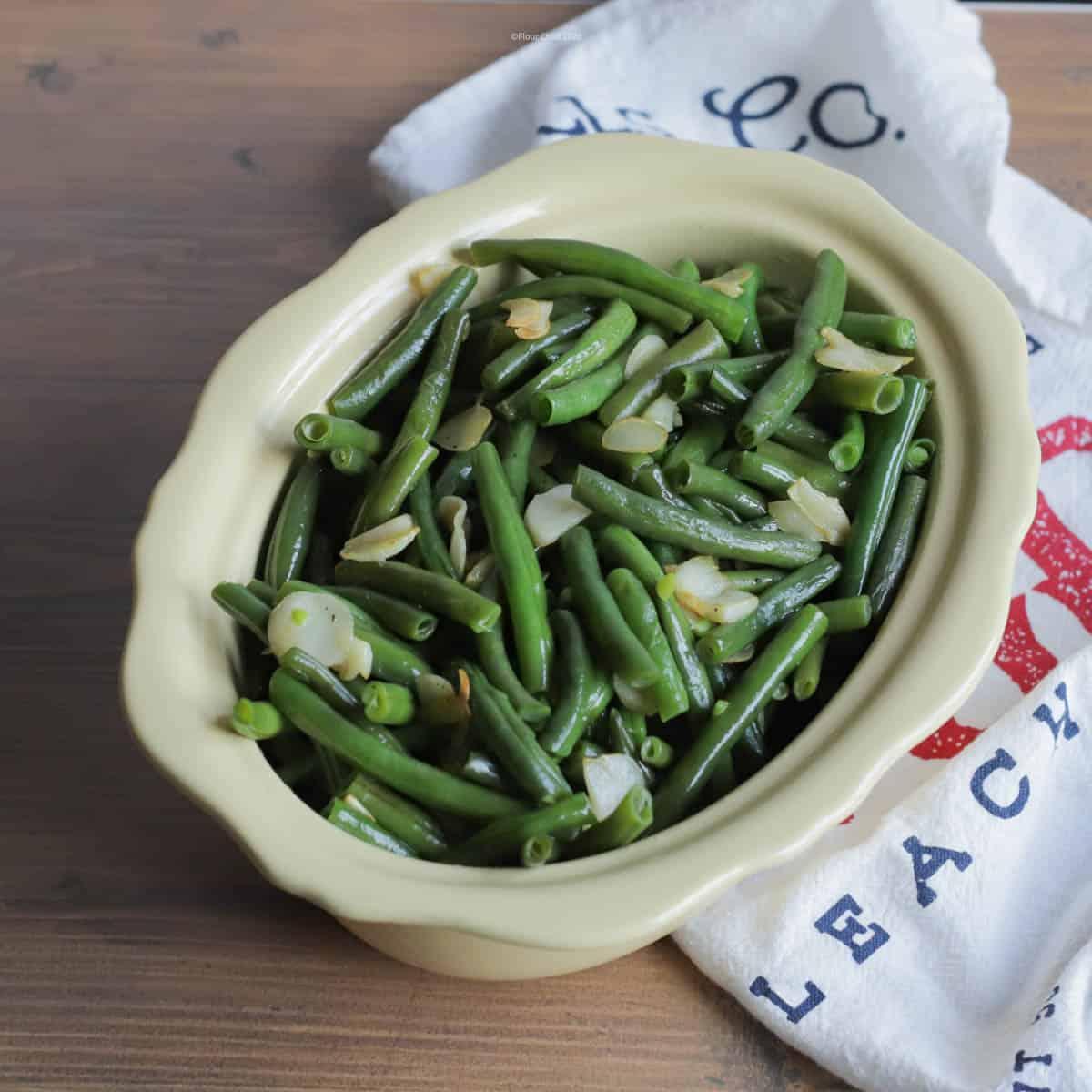 Fresh green beans with sautéed garlic slices make a farm fresh side dish