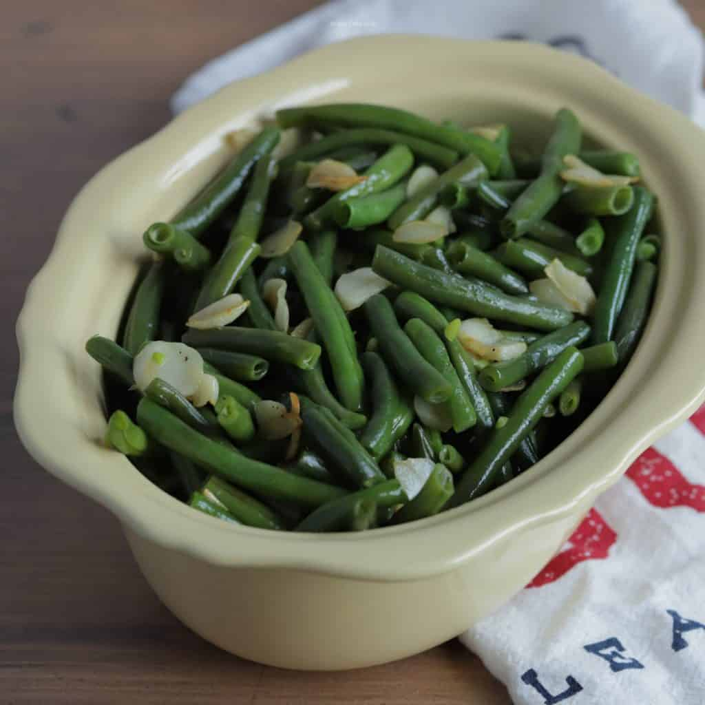 Large bowl of green beans with a serving spoon