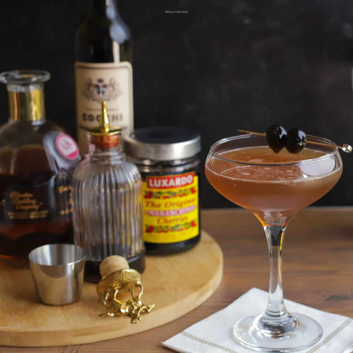 The Manhattan cocktail is a smooth classic made with bourbon, vermouth and bitters. A Luxardo cherry or two on a cocktail spike served in a coupe glass oozes sophistication.
