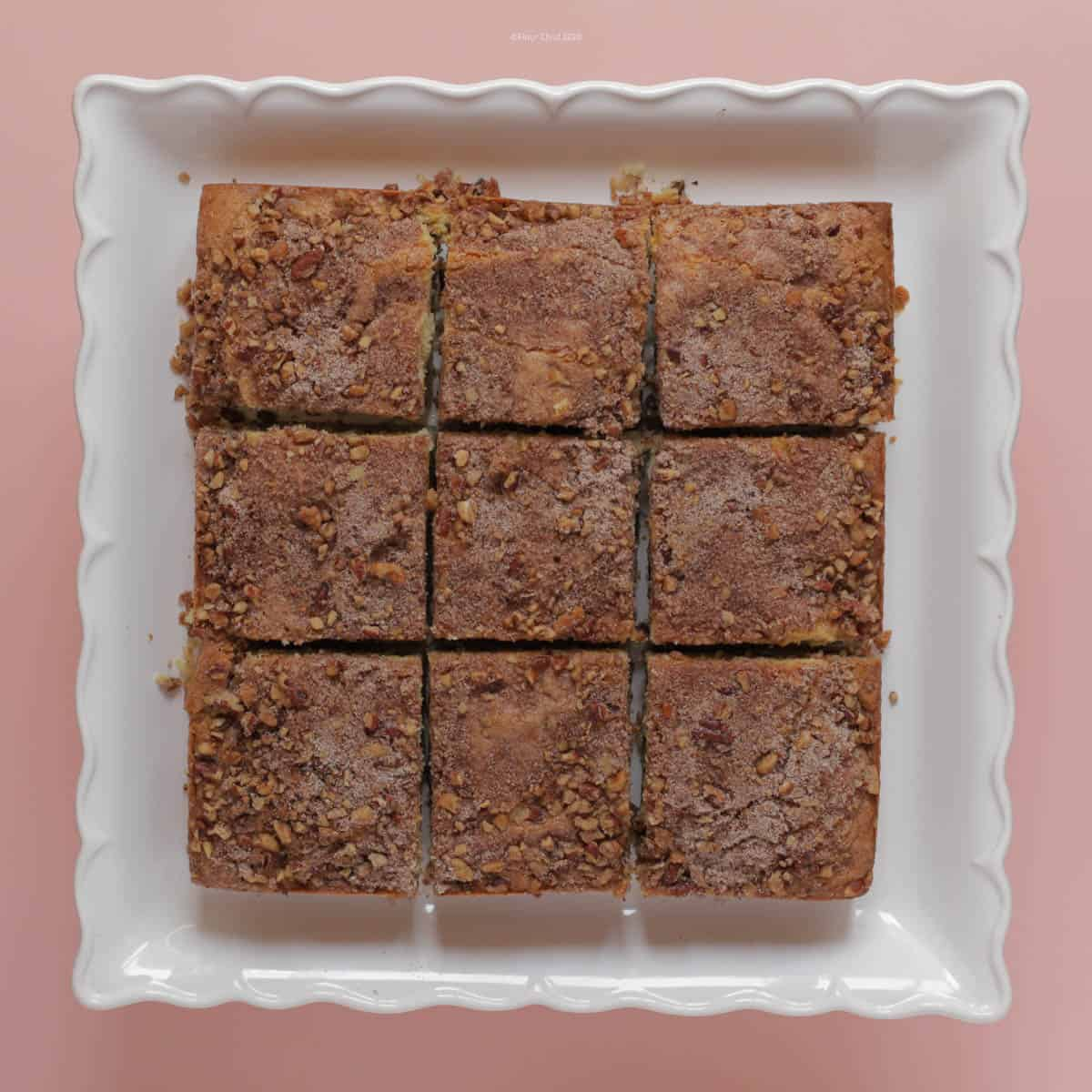 Coffee Cake cut into 9 squares sitting on a pedestal platter