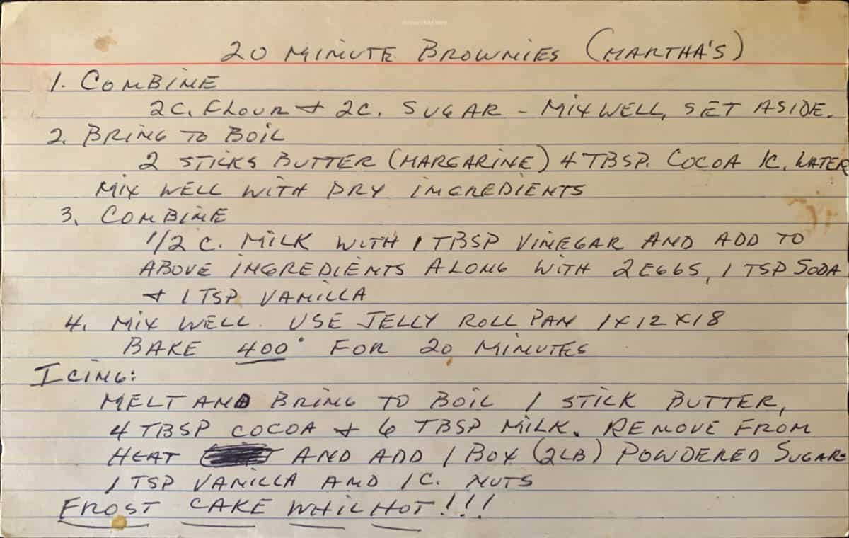 A large index card with the hand written recipe for 20 minutes brownies on it