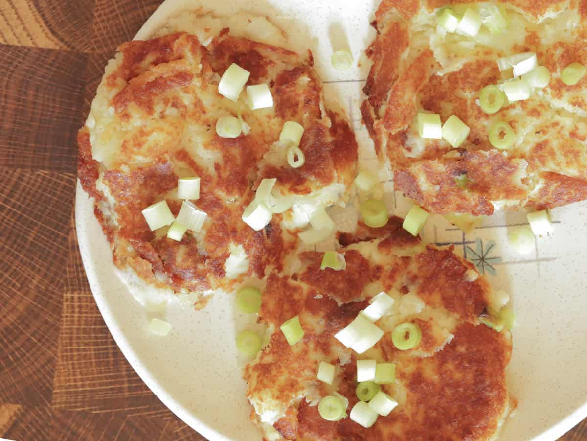Hearty leftover mashed potato pancakes on a mid century plate