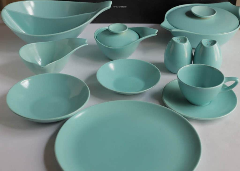 The blue setting of Monterey dishware add a touch of flair to mid century place settings.