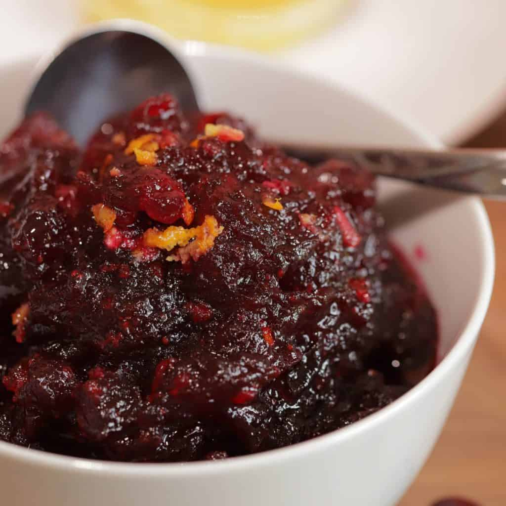 Cranberry sauce in a white bowl.
