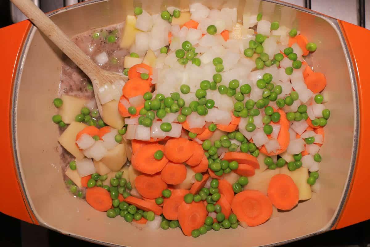 Beef Burgundy Stew Step 4: Add water, potatoes, peas, carrots, salt and pepper.