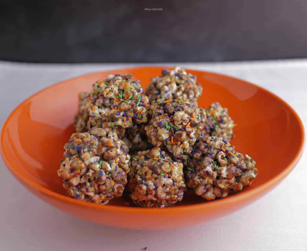 Old fashioned popcorn balls with melted candy stuck to them!