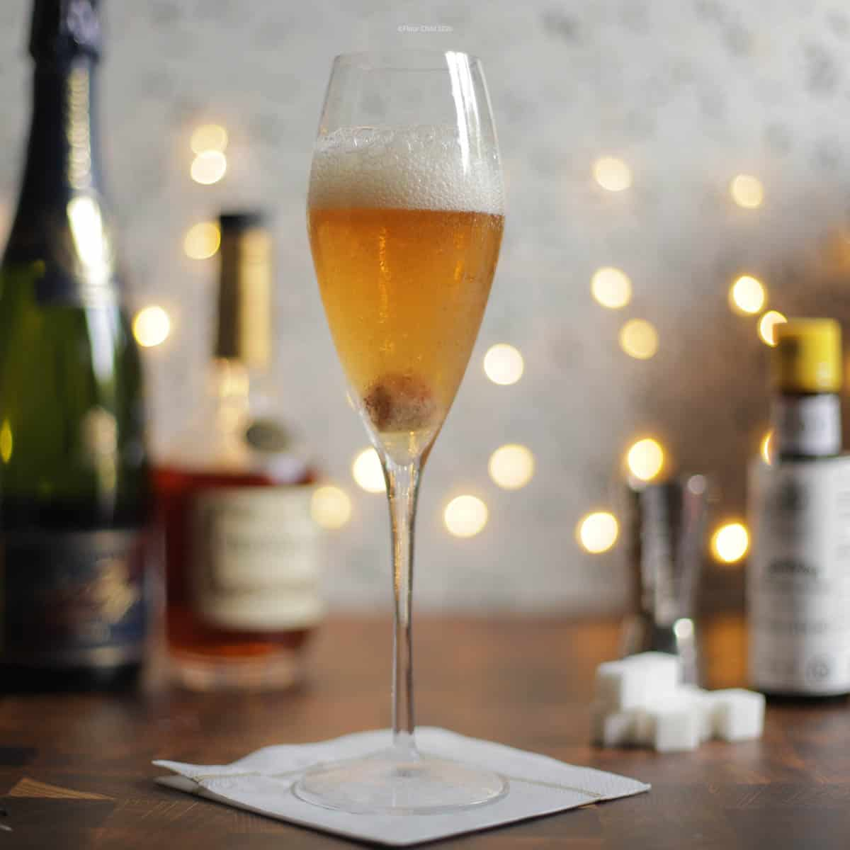 Champagne Cocktail with a white sparkly background