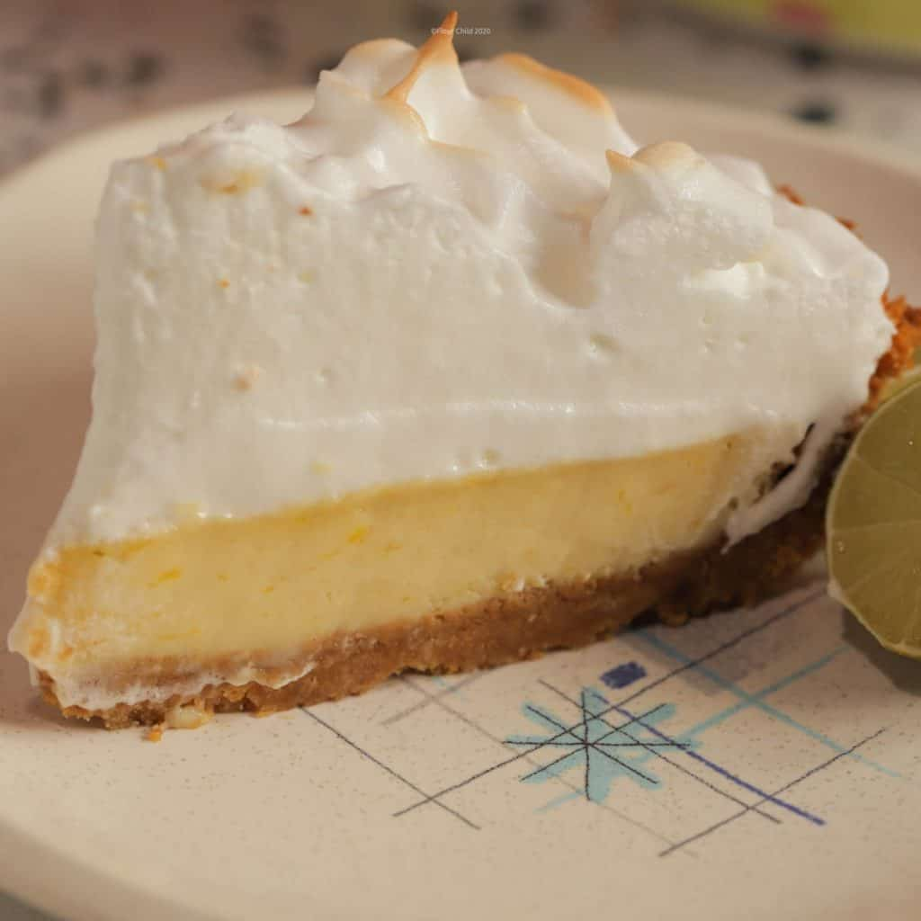 Perfect slice of key lime pie topped high with brown-tipped meringue