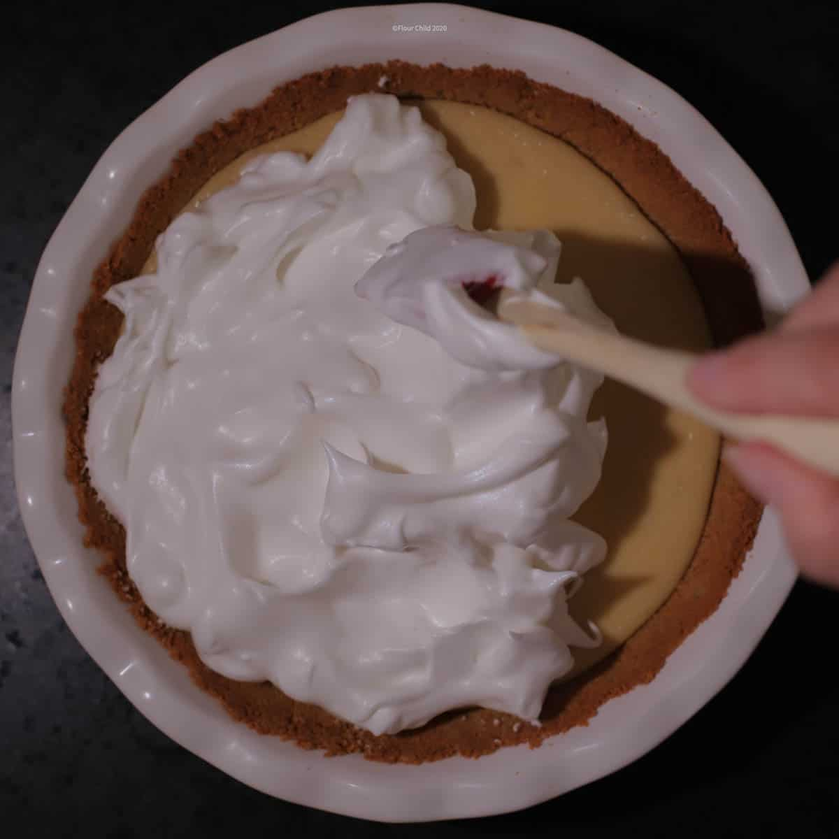 Adding meringue to the top of the pie
