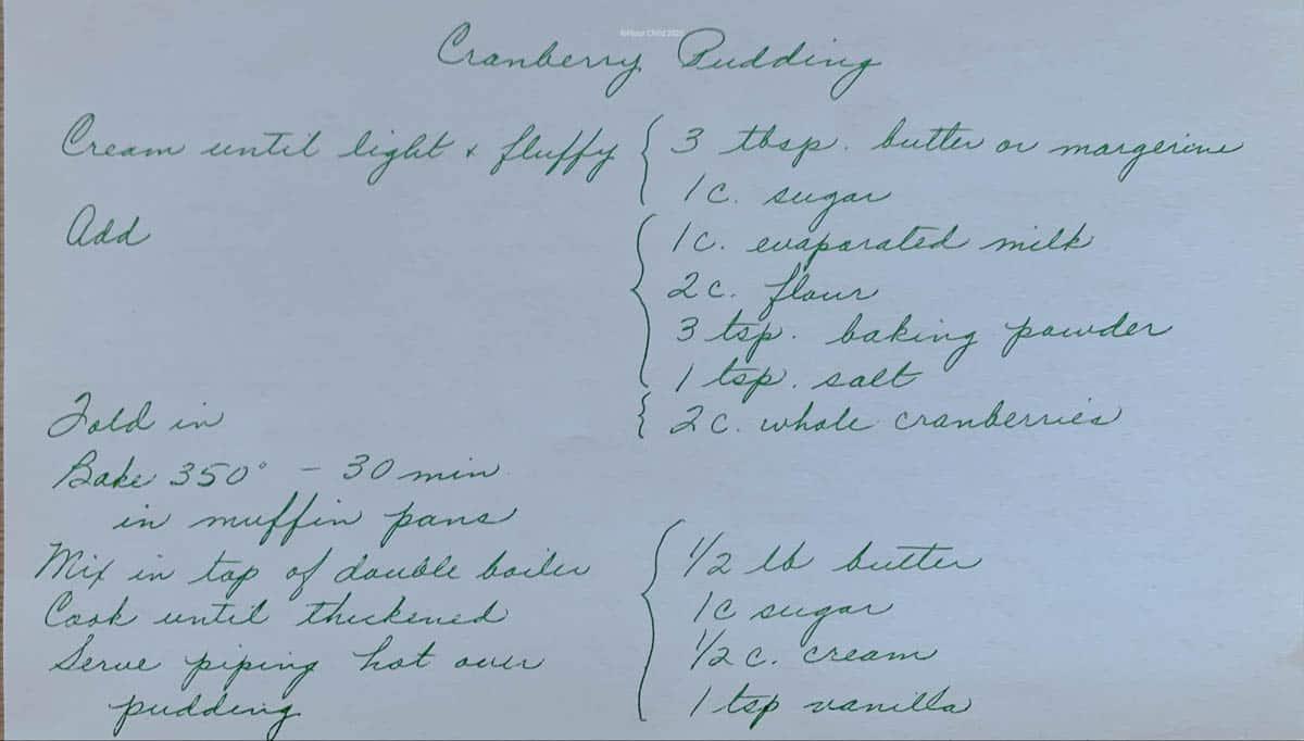 Original handwritten recipe card for cranberry pudding with butter sauce.