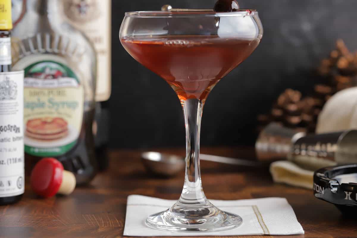 Closeup of a maple manhattan in a coupe glass