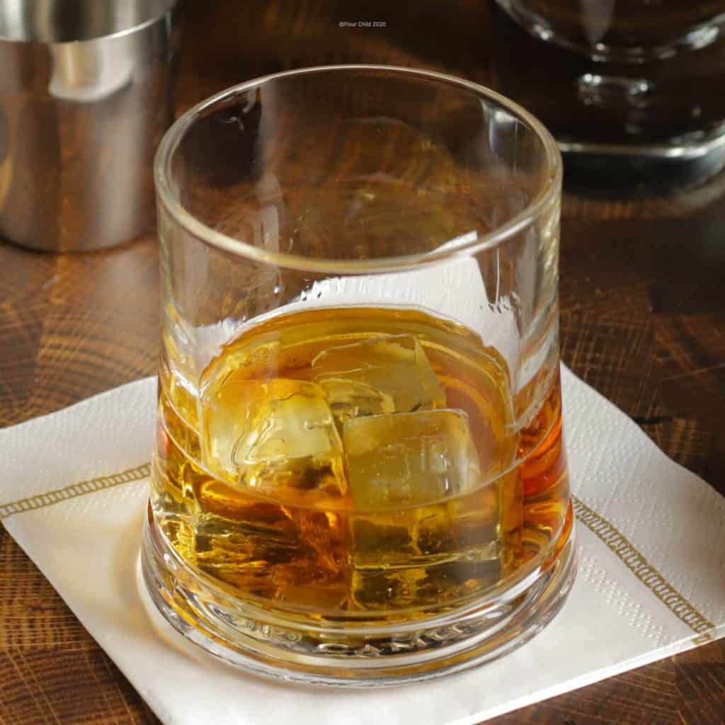A closeup of a whiskey in a rocks glass
