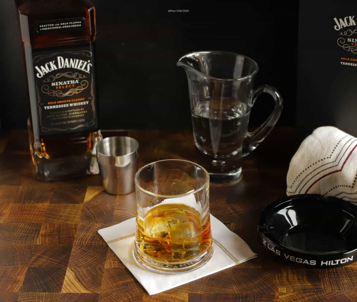 A rocks glass with Jack Daniels Sinatra Select whiskey.