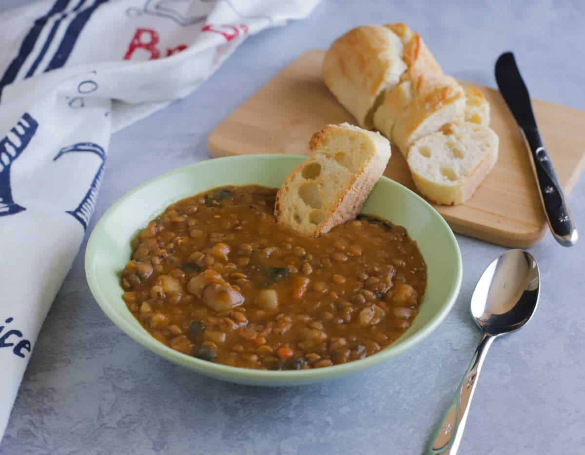 Bowl of Lentil soup with sliced bread
