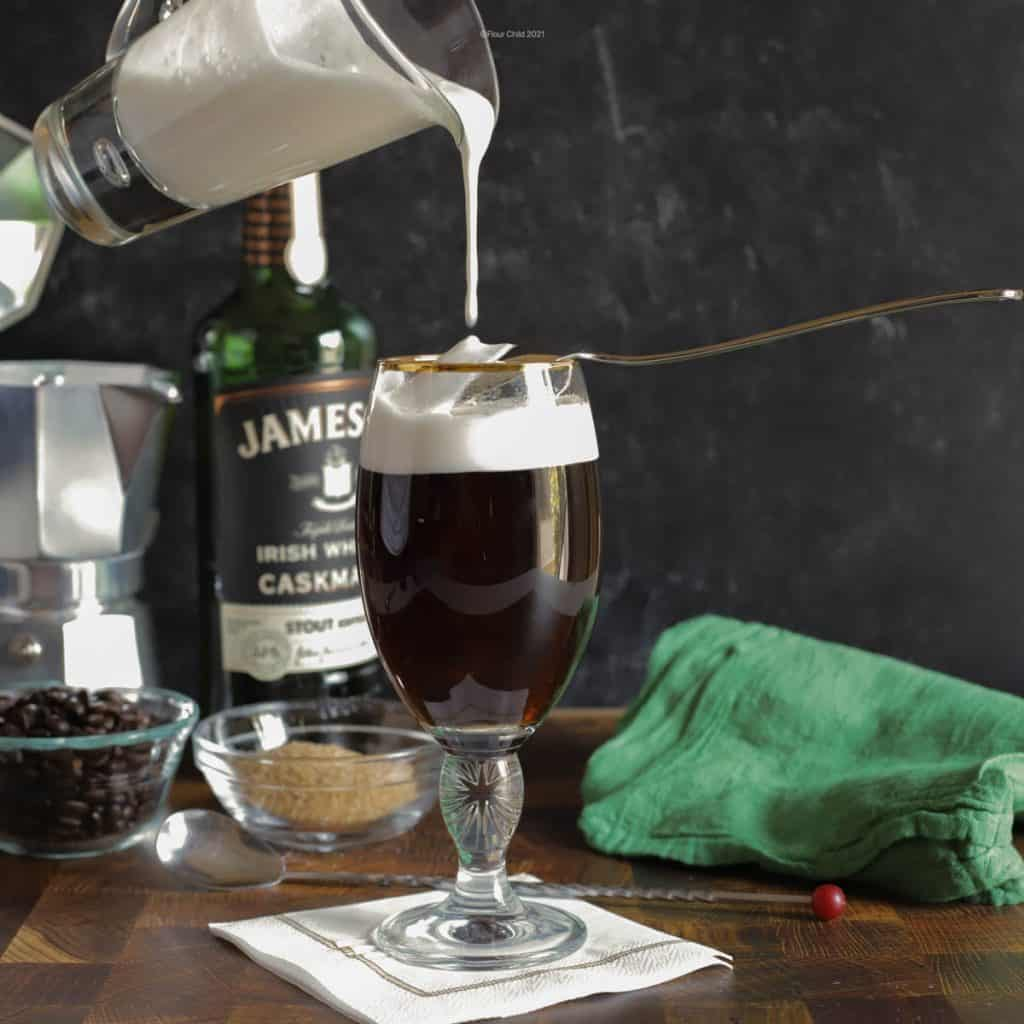 A hot coffee glass with Irish Whisky and cream