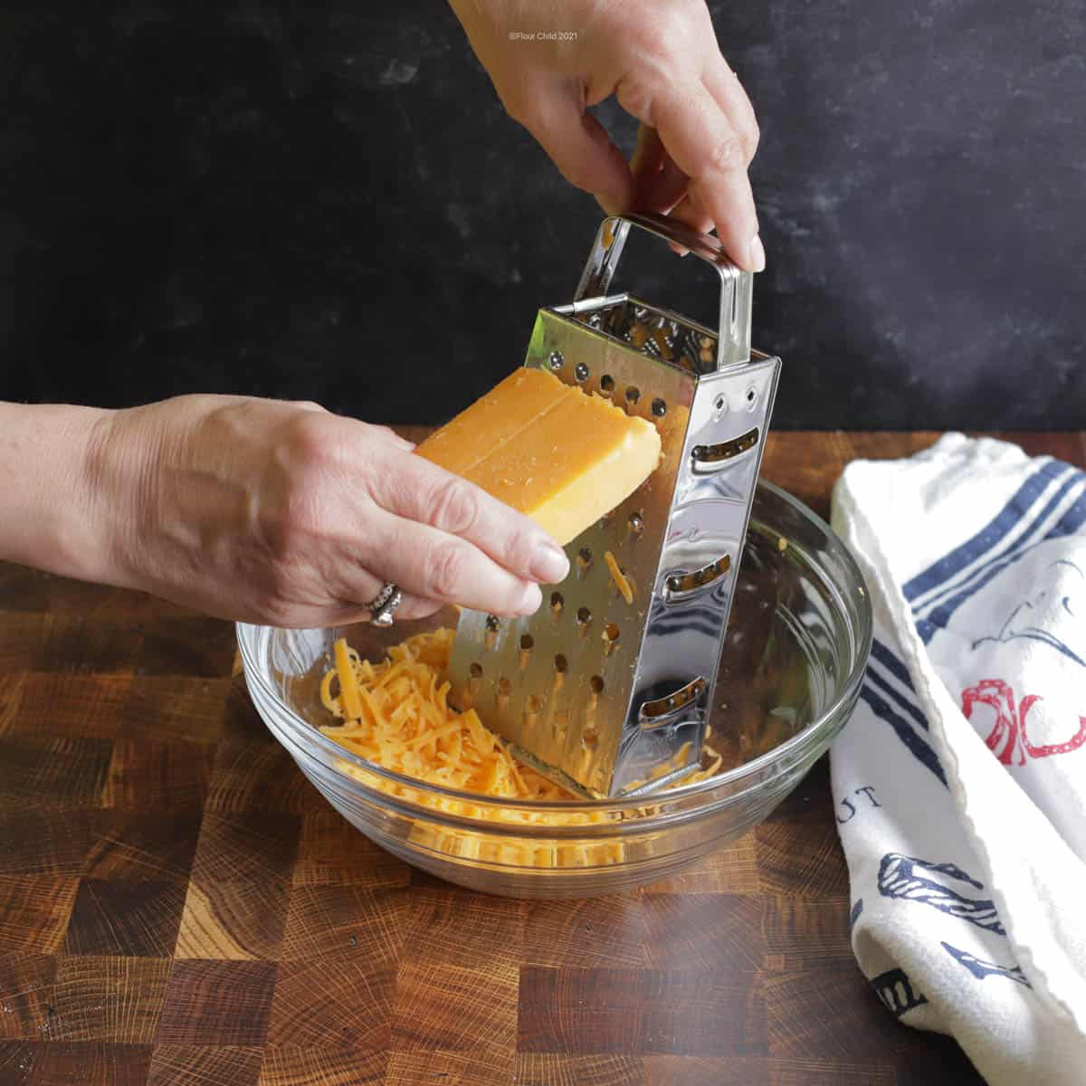 Grating cheese with a box grater