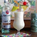 a pina colada tiki cocktail in a hurricane glass.