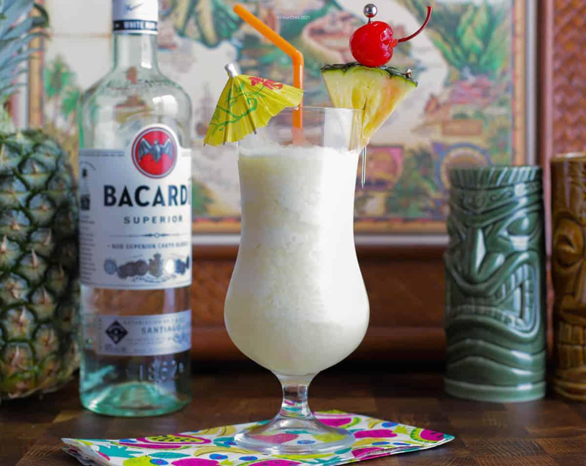 a pina colada tiki cocktail in a hurricane glass