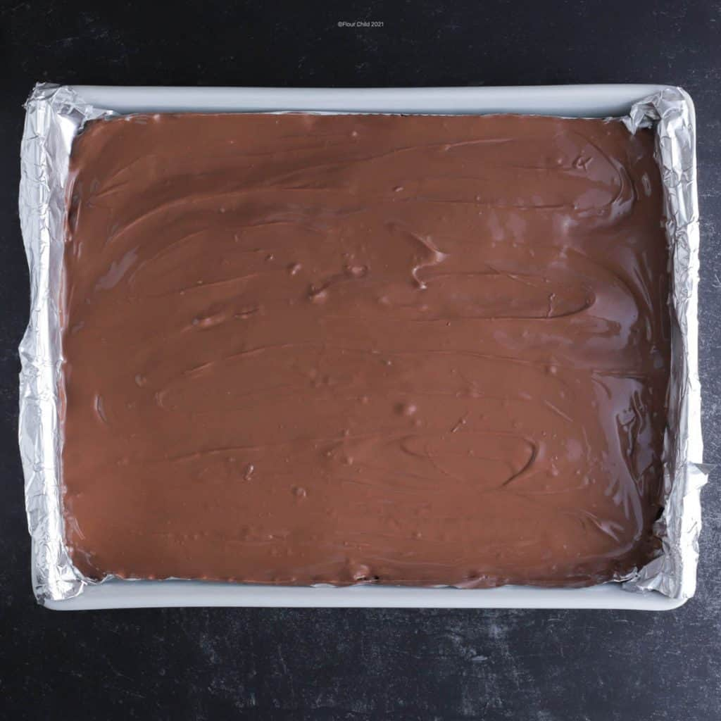 Chocolate frosting over top of oatmeal bars