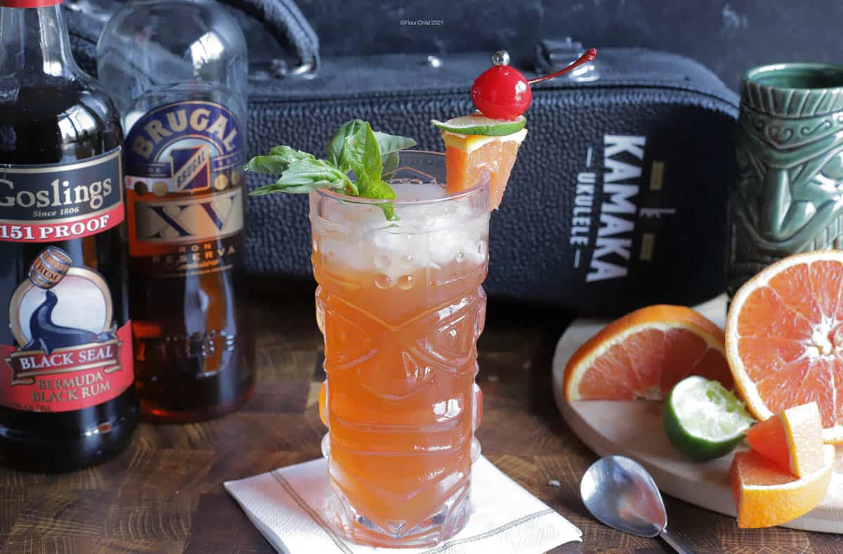 A Zombie Tiki cocktail in a clear tiki mug