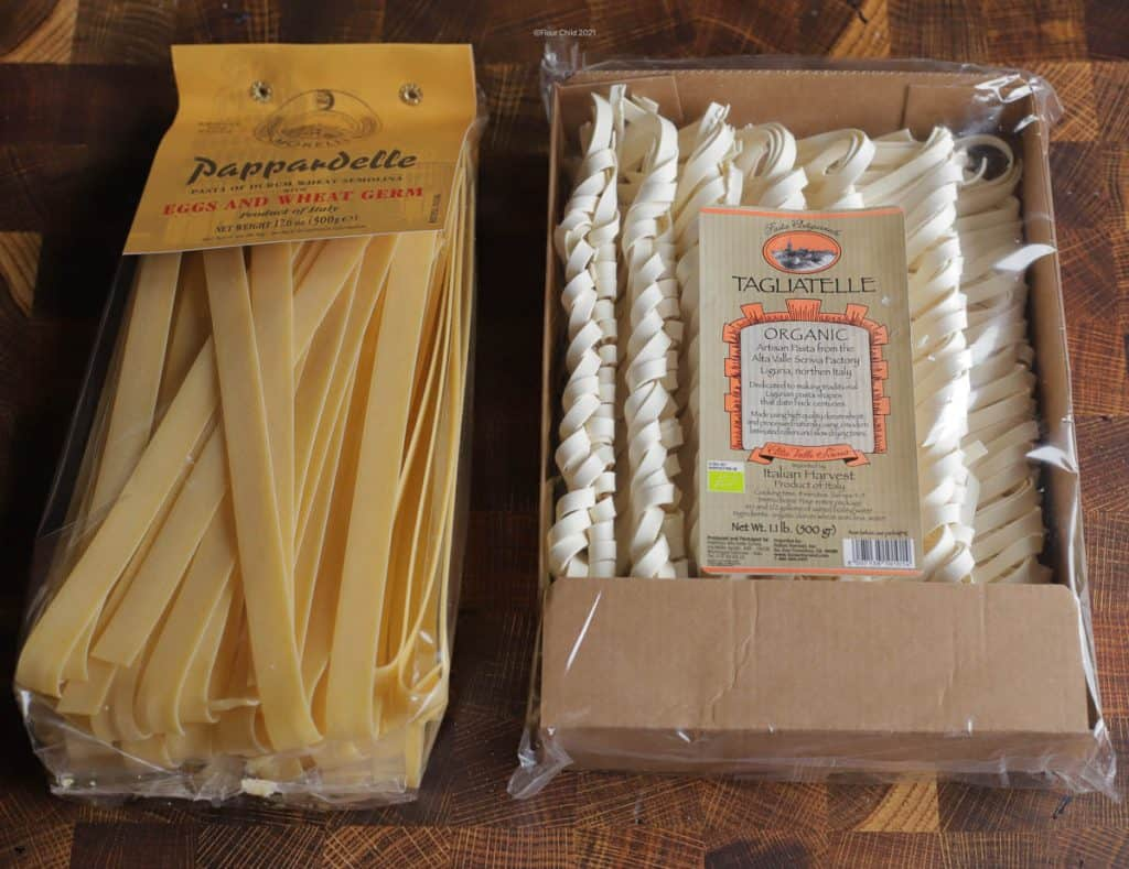 Packages of pappardelle and tagliatelle pasta, side by side