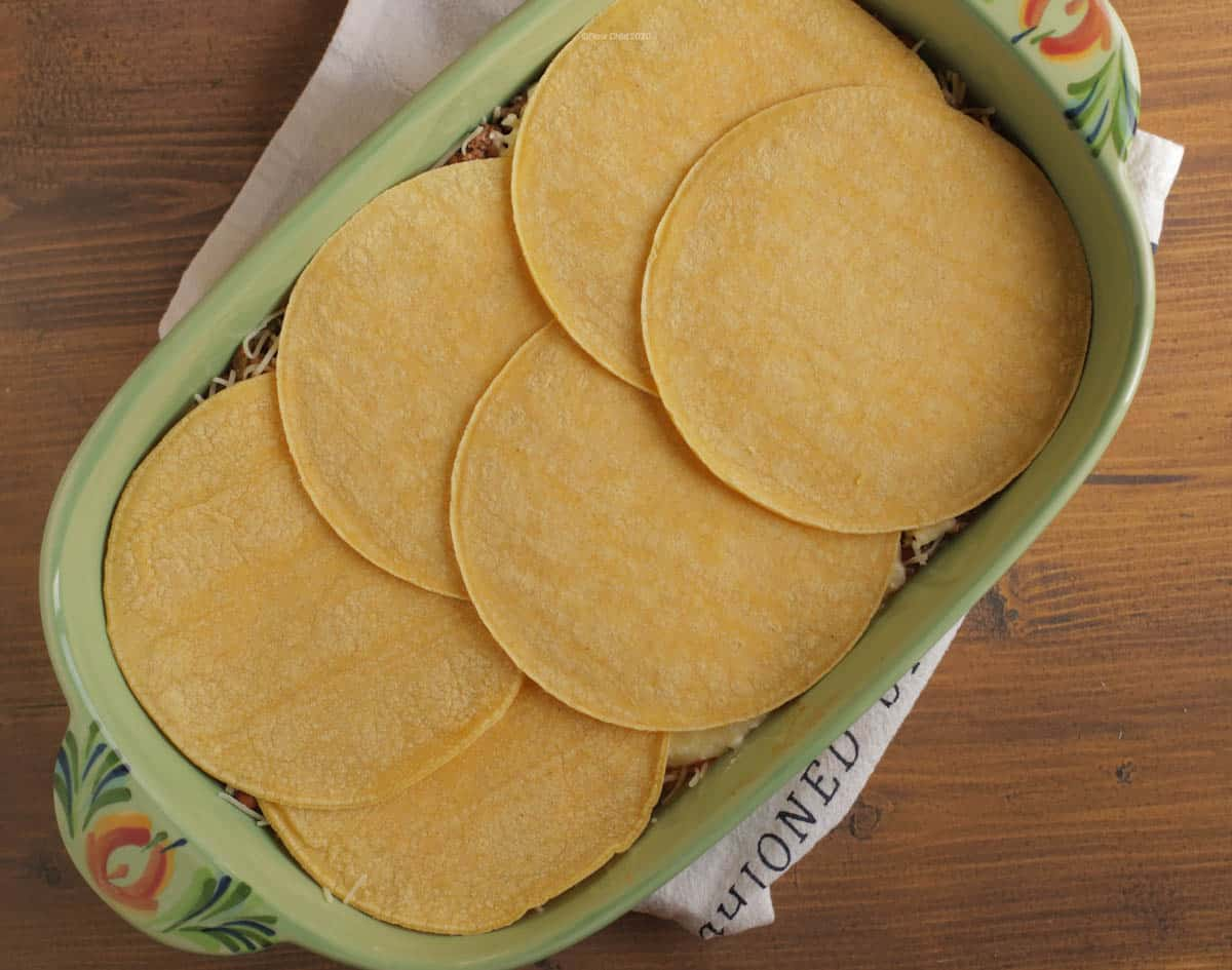 Layer of tortillas on top of cottage cheese mixture in 9 x 13 pan