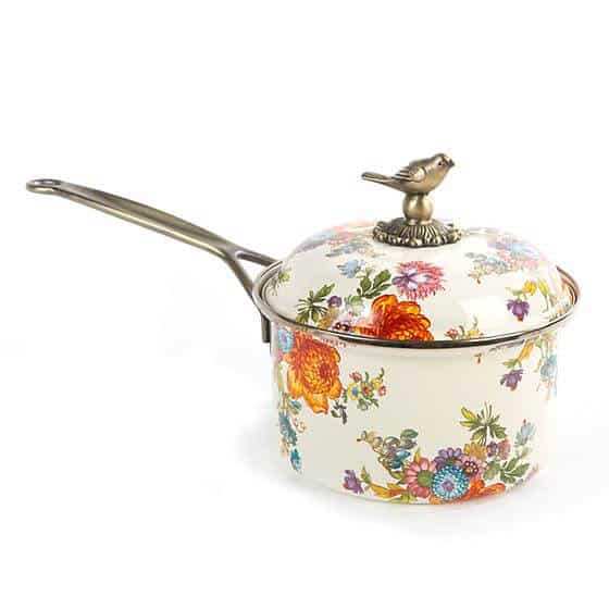 Small floral saucepan with ivory background, long brass handle and decorative brass bird on top of lid