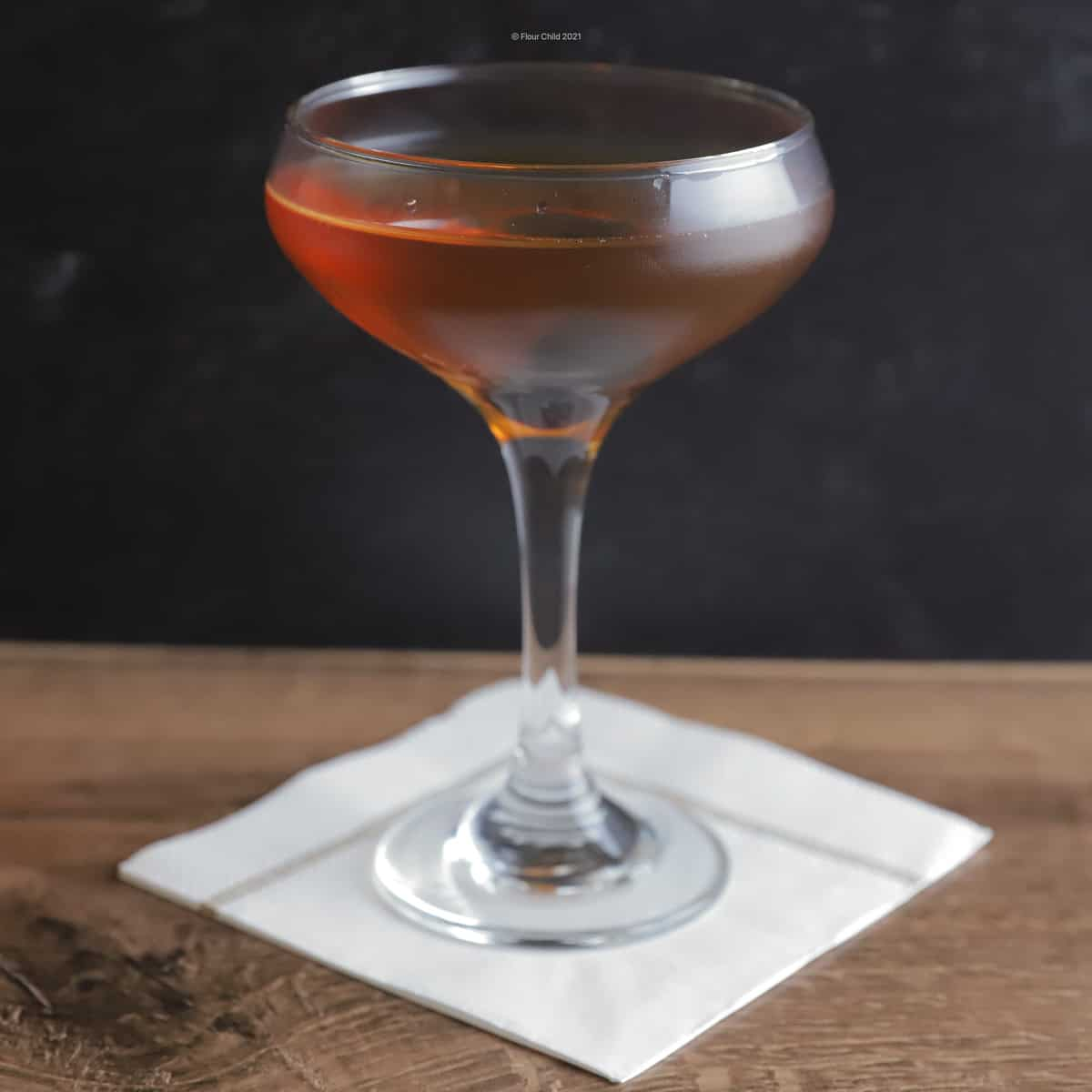 The simple, elegant Manhattan cocktail with Bourbon in a cocktail glass