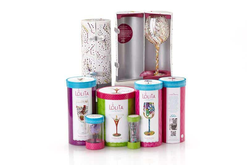Six gift packaged boxes of artisan wine glasses with one open showing contents inside