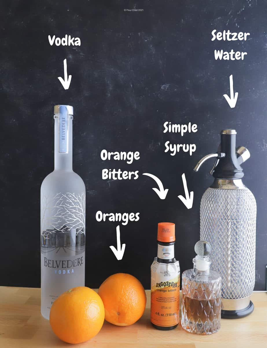 The ingredients needed for a delicious Screwdriver cocktail include vodka and orange juice but we add extras like orange bitters, simple syrup and a spritz of seltzer.