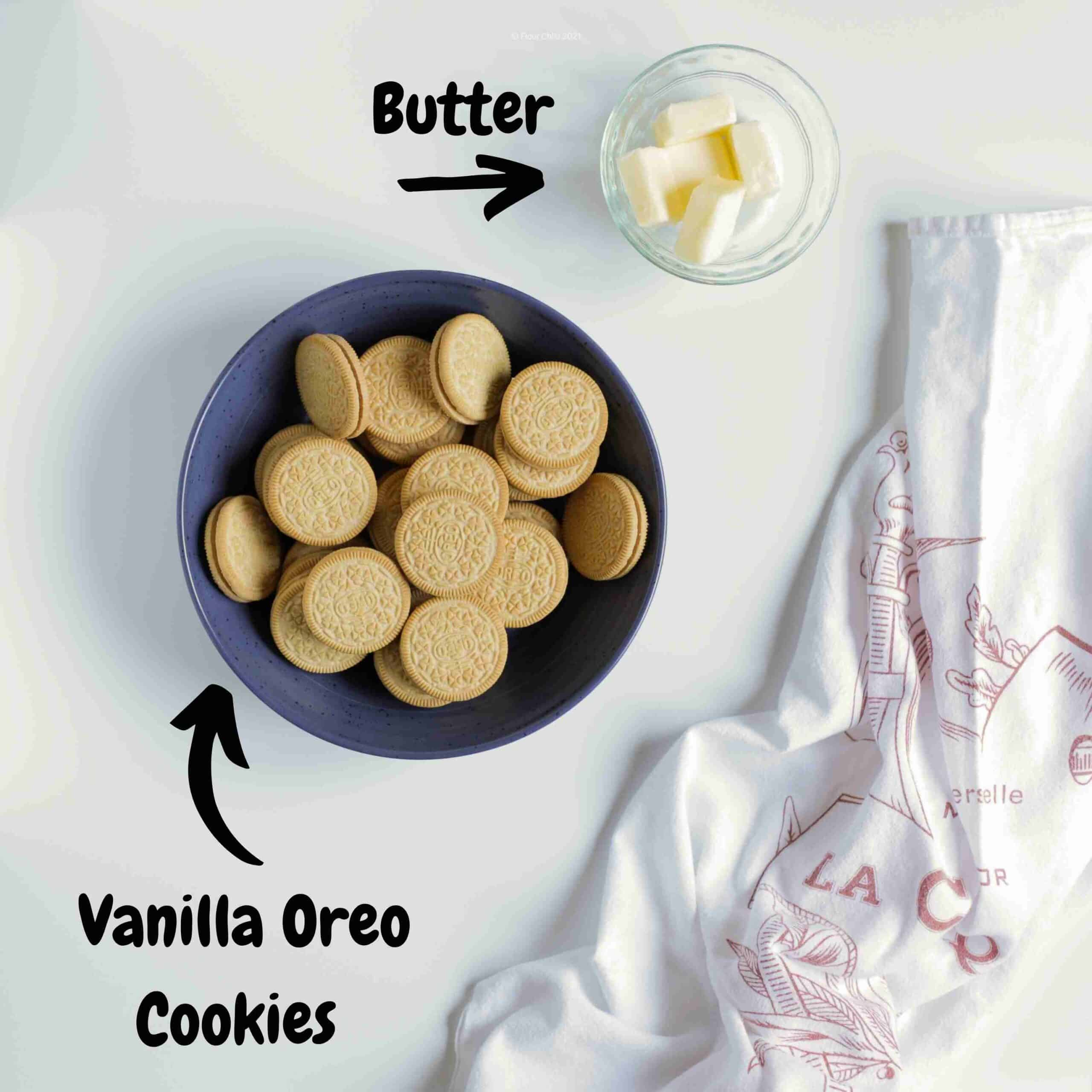 Vanilla Oreo cookies in a bowl with a small bowl of butter next to it